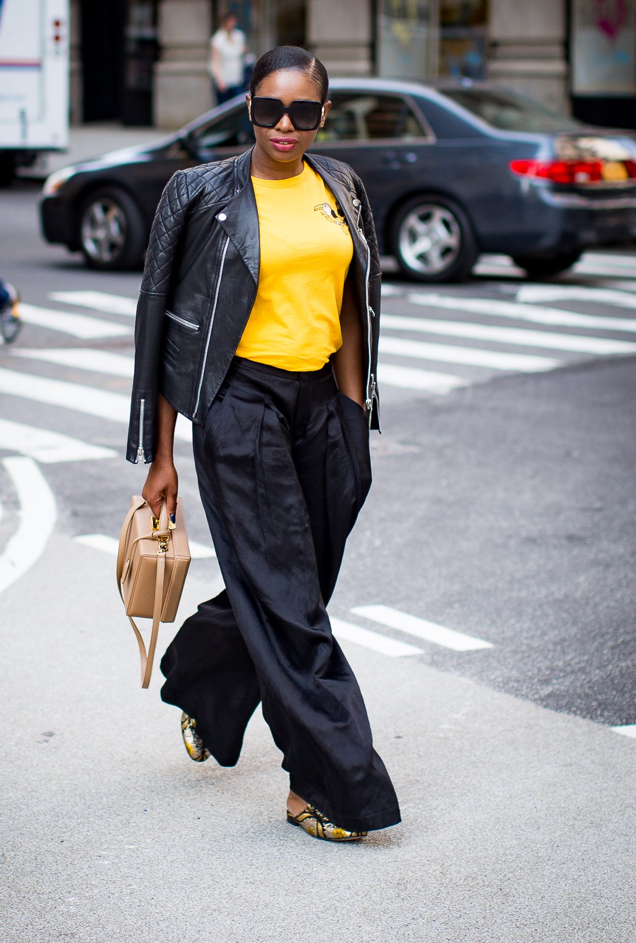BLACK BIKER JACKET, WIDE LEG PANTS AND YELLOW TEE