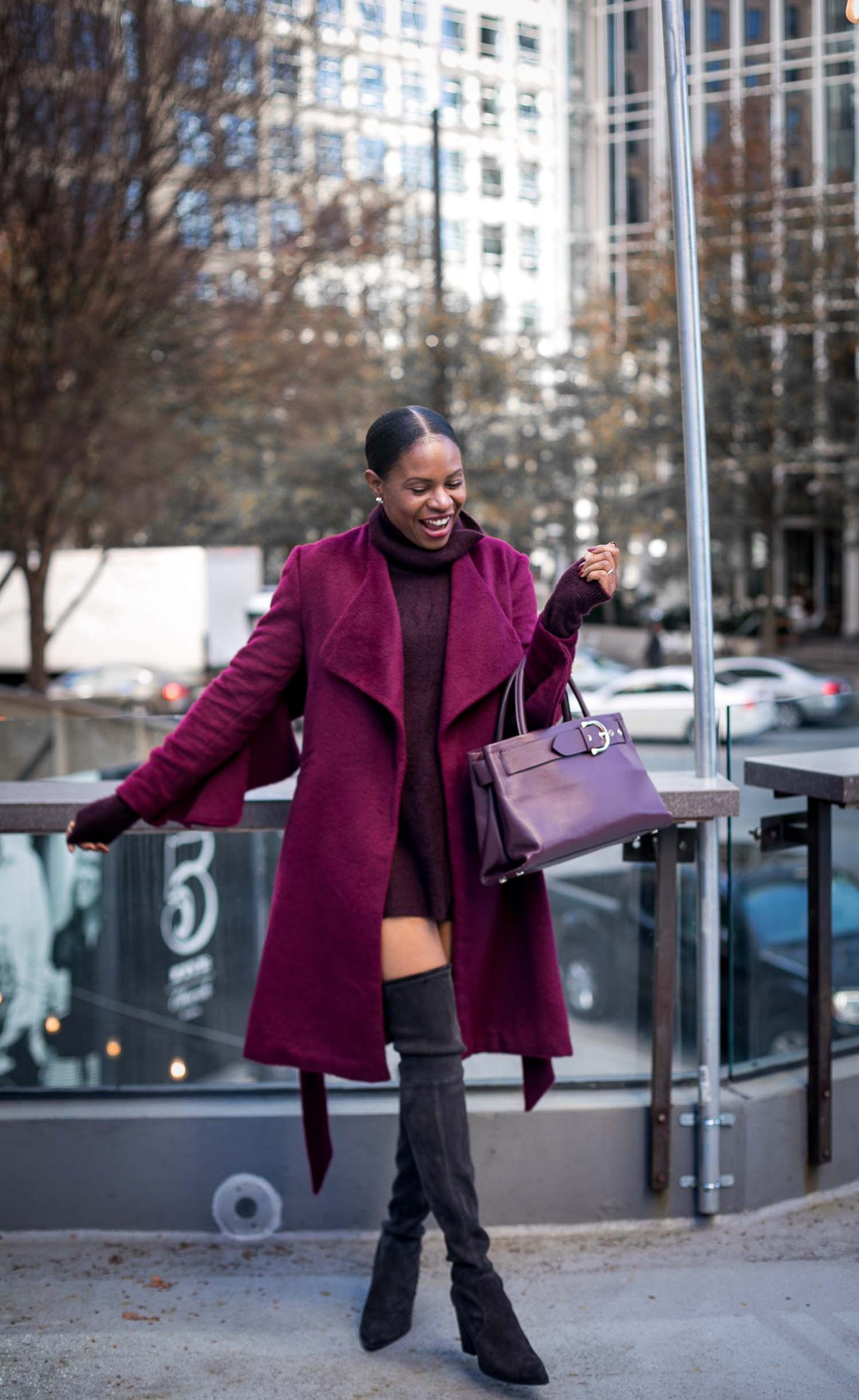 fashion blogger wearing a burgundy coat