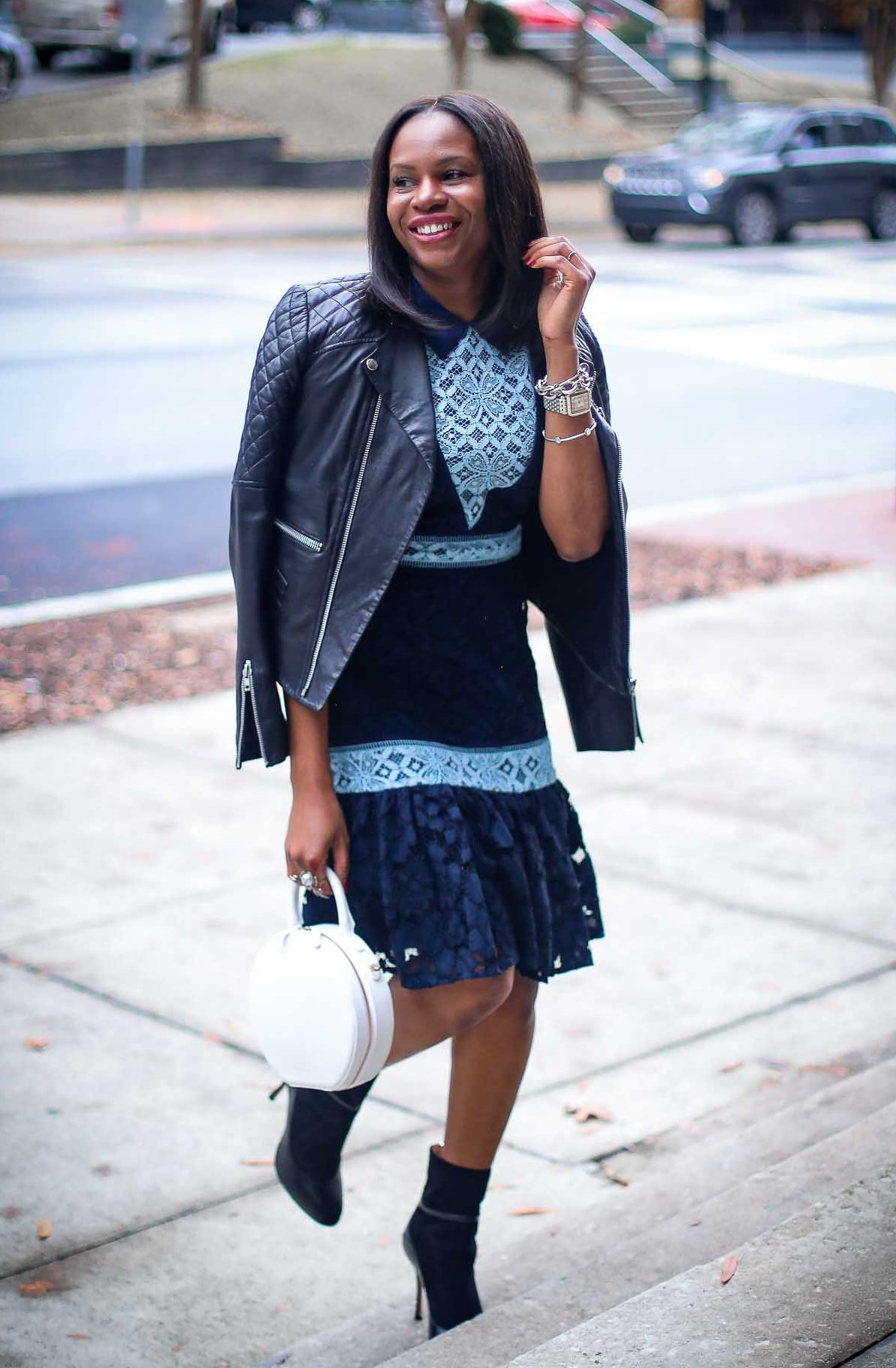 blue lace dress and mansur white circle bag