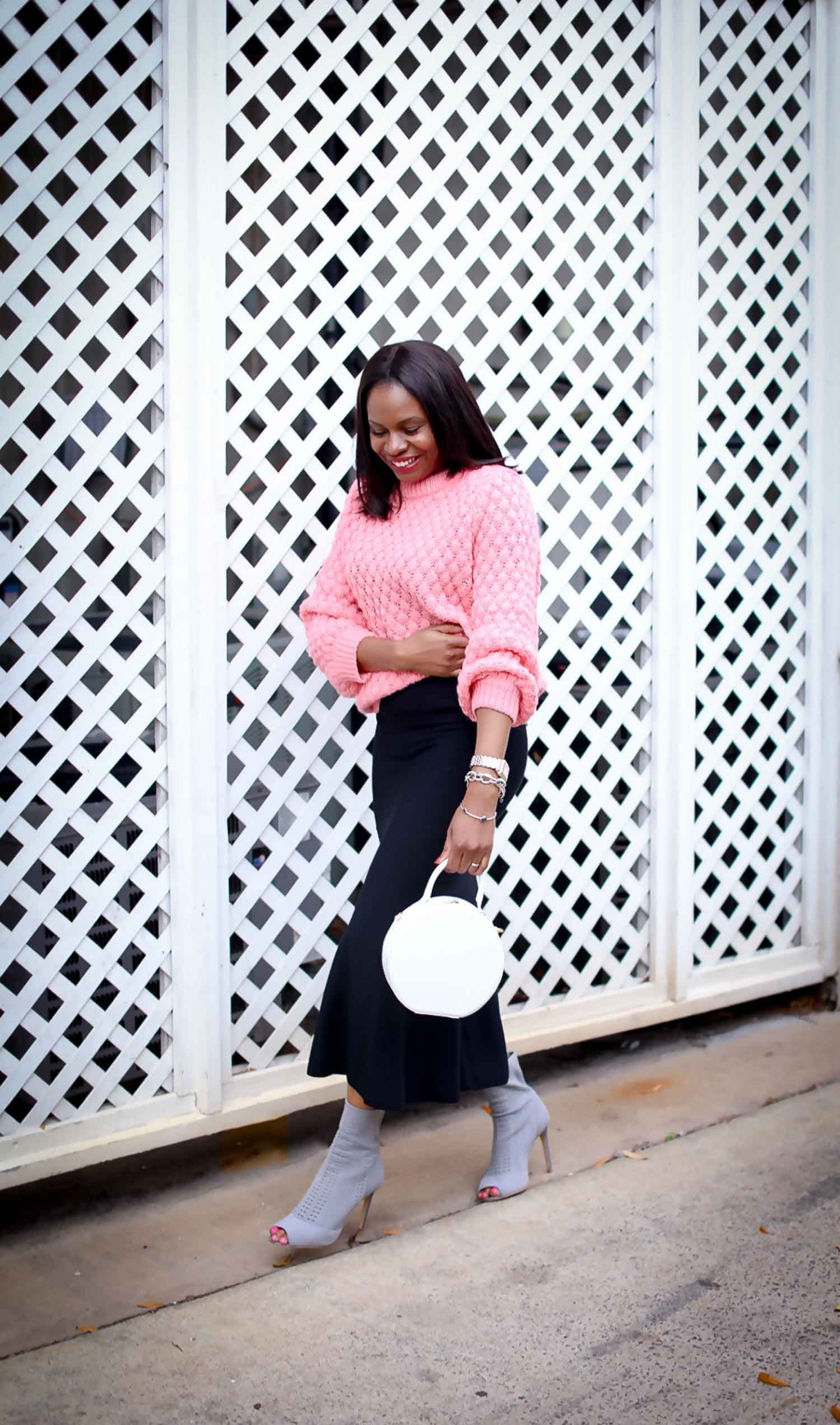 462c0fc275 H&M pink chunky sweater worn with a black midi skirt by Atlanta style  blogger and white circle bag by mansur-8 - Awed by Monica