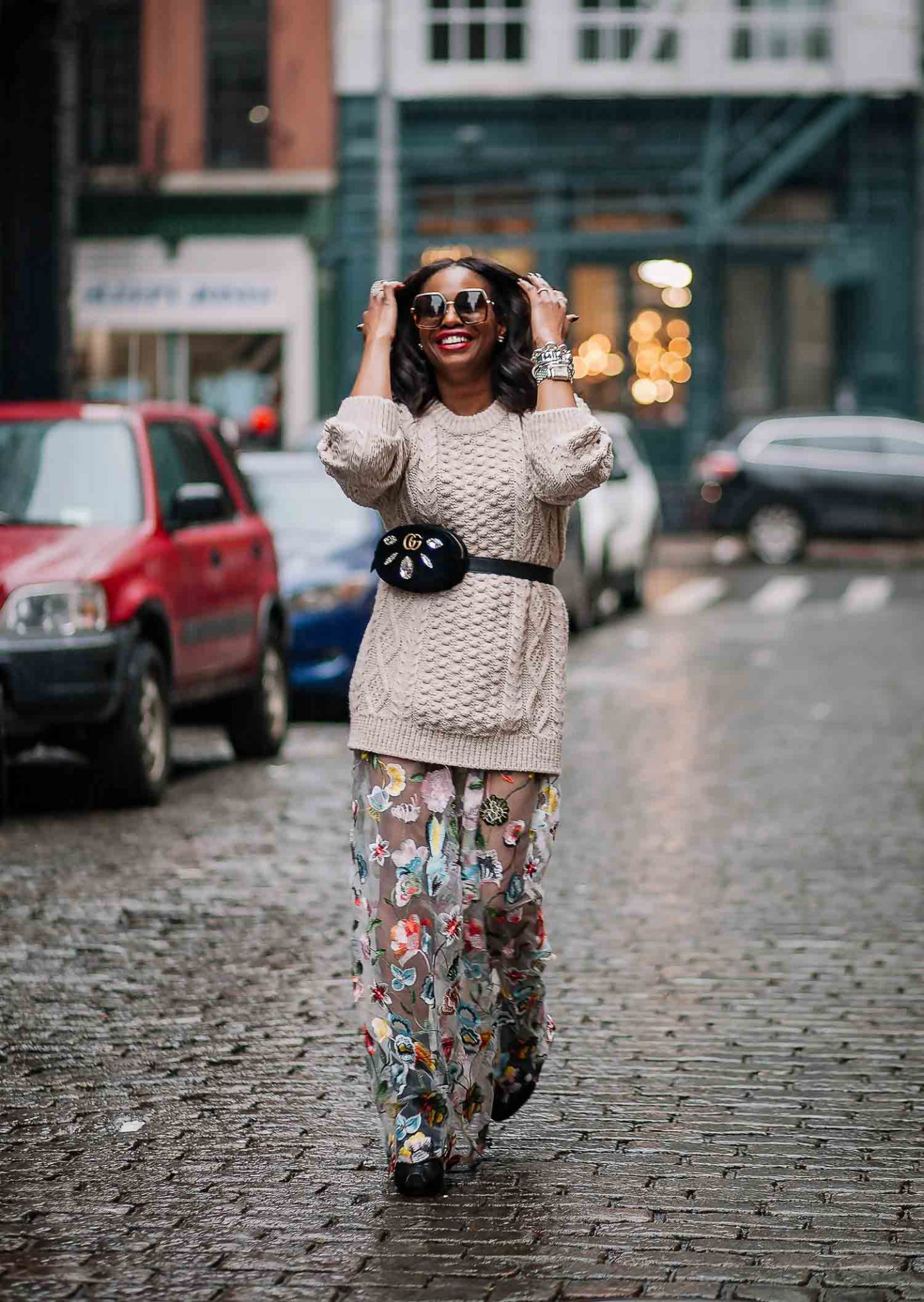 CAUGHT IN THE RAIN IN A CHUNKY SWEATER AND FLORAL DRESS