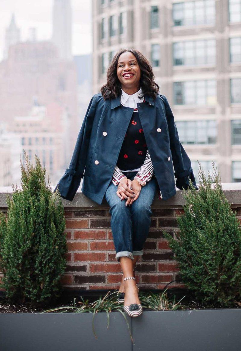 Fashion blogger wearing a ladybug sweater