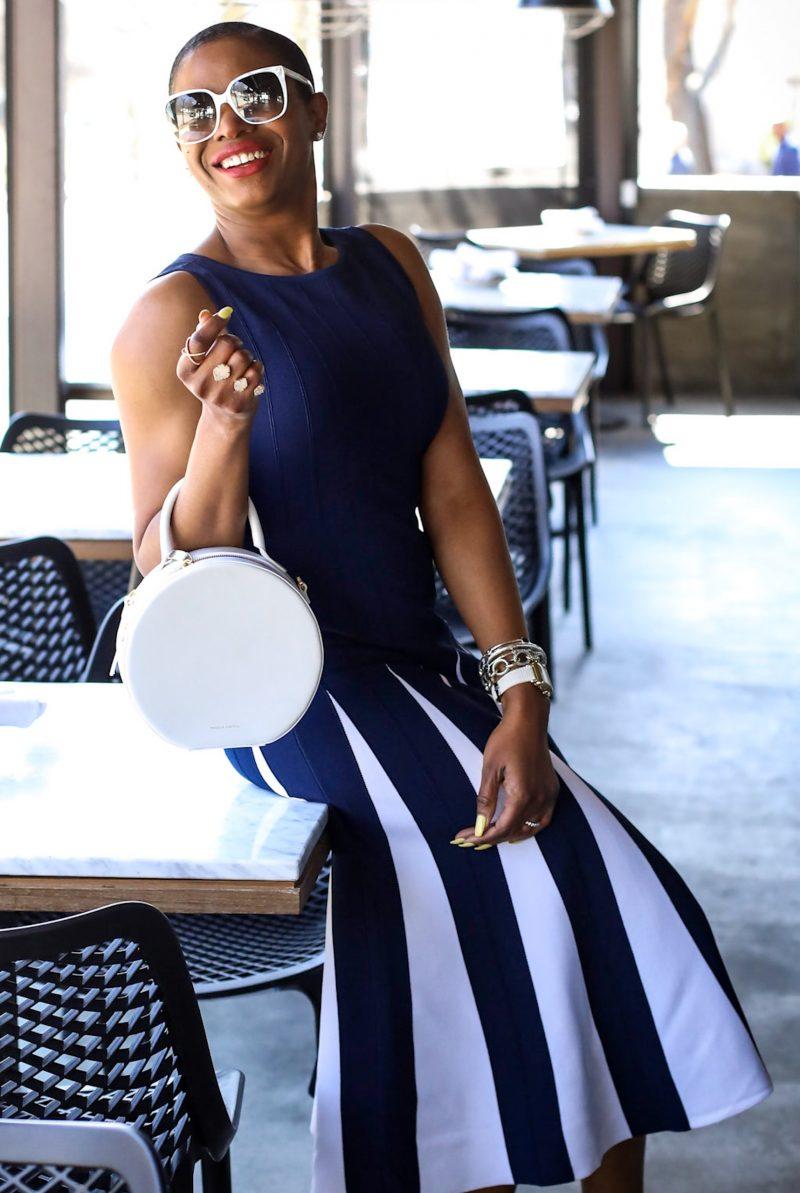 Blogger wearing New York & Co. Eva Mendes dress for spring