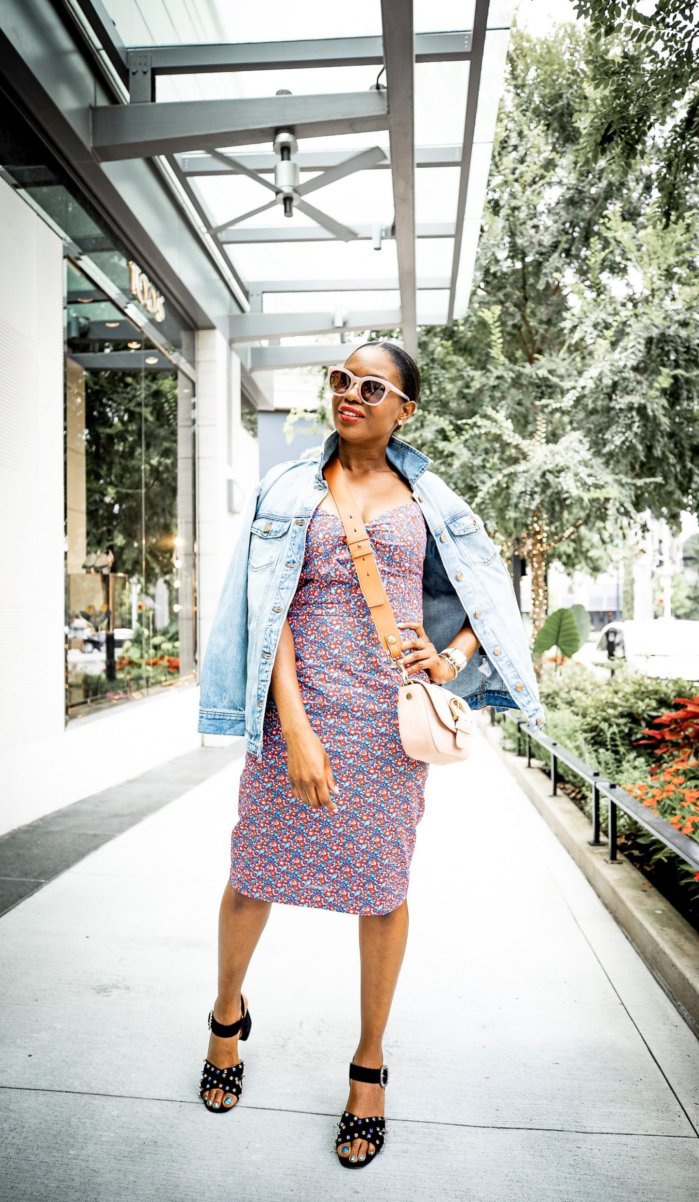 Lifestyle blogger Monica Awe-Etuk of Awed by Monica wearing J.Crew floral dress, denim jacket and black suede sandals for fall fashion