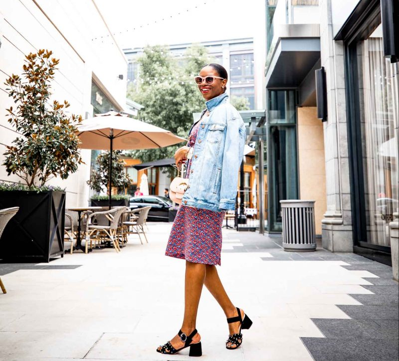 Atlanta lifestyle blogger Monica Awe-Etuk wearing J.Crew floral print dress with boyfriend denim jacket, Suede Penny sandals with crystals, and pink sunglasses