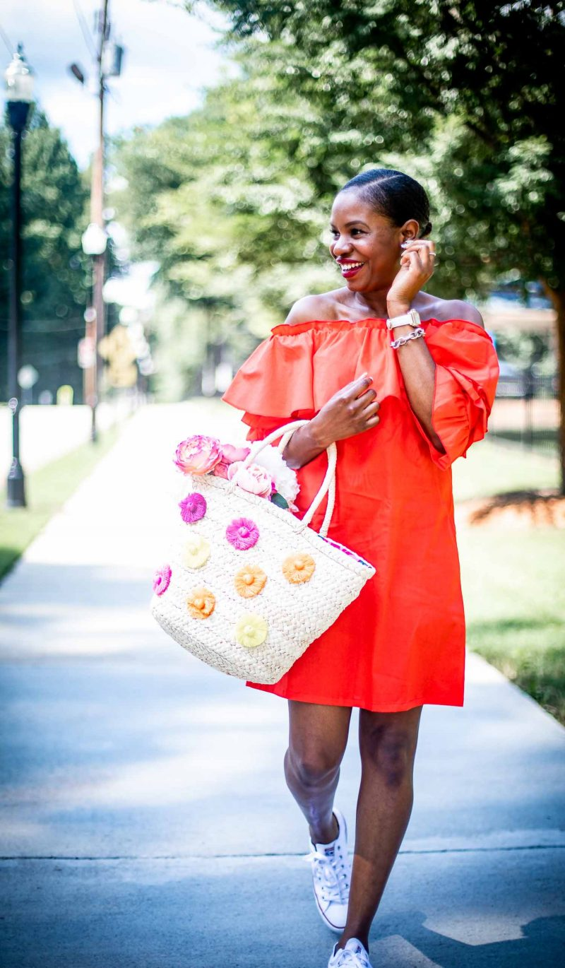 Atlanta fashion and Lifestyle blogger Monica Awe of Awed By Monica wearing a orange off-the-shoulder dress to the park.