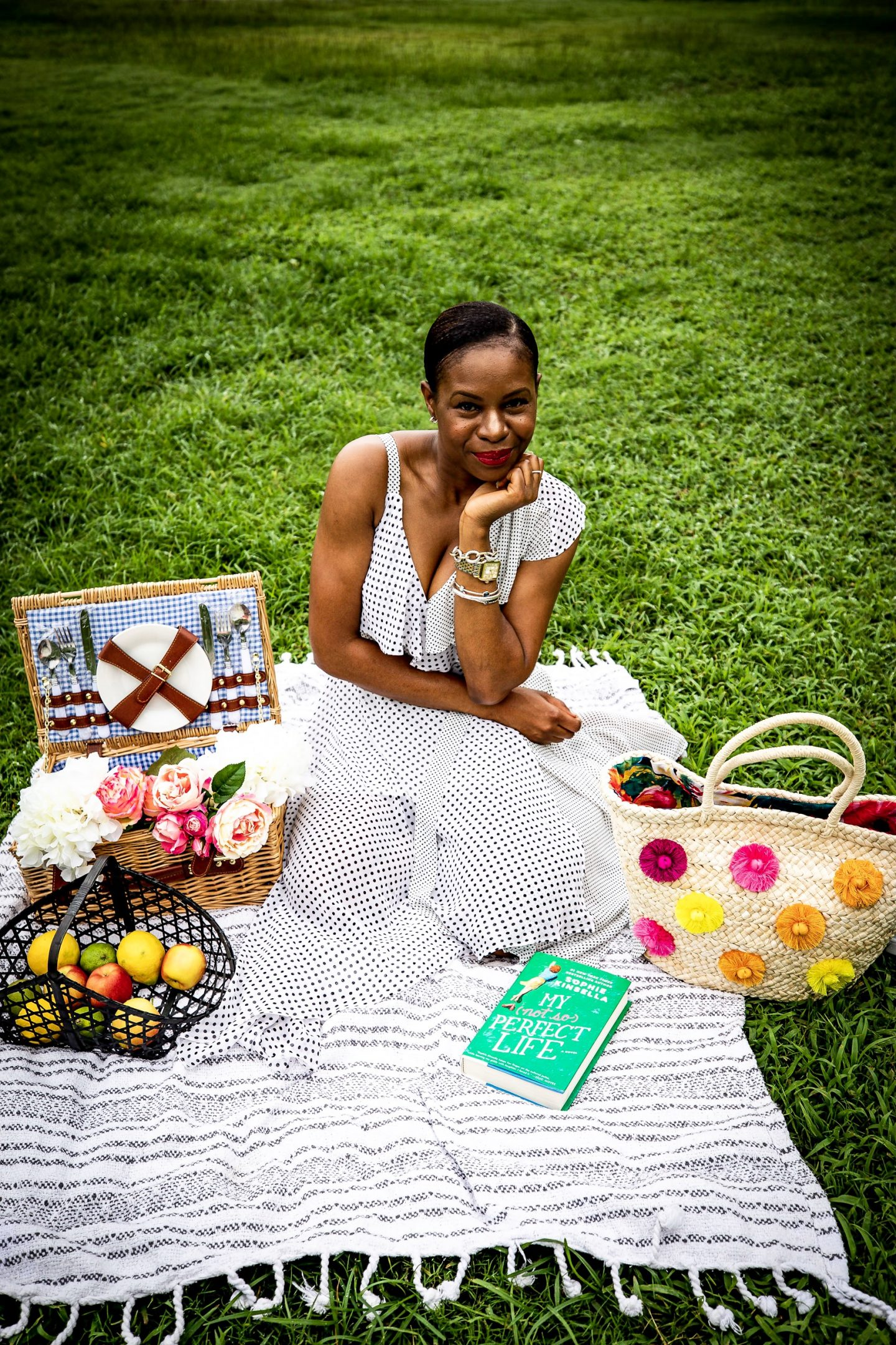 Atlanta fashion and lifestyle blogger Monica Awe of Awed By Monica wearing a polkadot cold shoulder dress to a picnic.