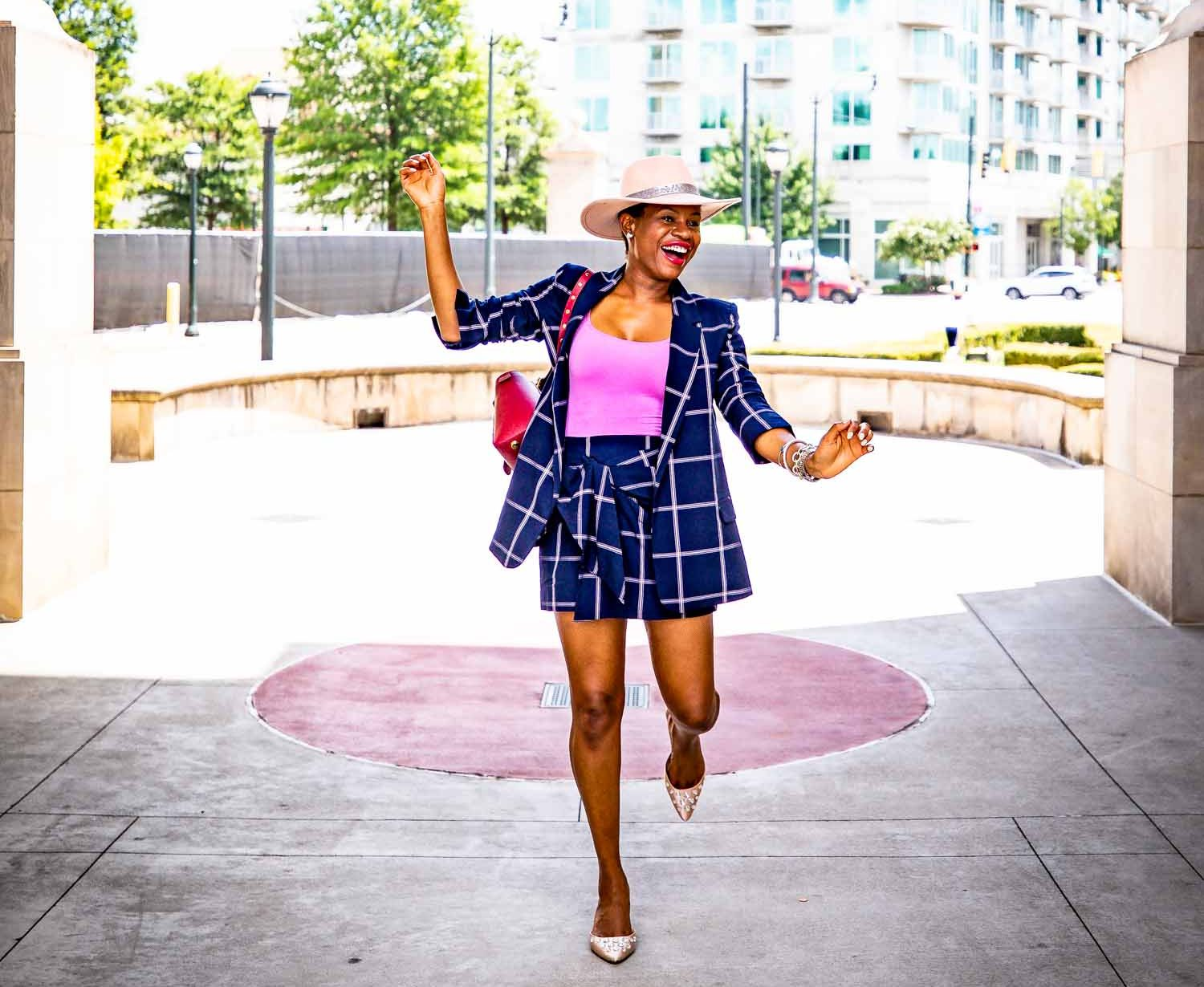 Fashion blogger Monica Awe-Etuk of Awed by Monica wearing a plaid suit from nordstrom, pink flats, a pink hat and a SENREVE bag for fall fashion