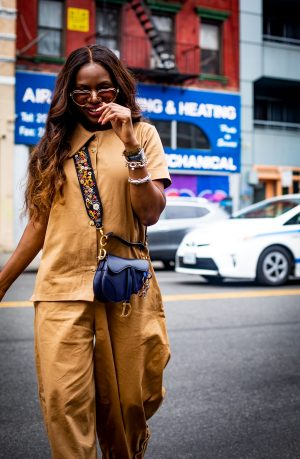 3 tips on how to look chic in a utility jumpsuit. Atlanta fashion and lifestyle blogger Monica Awe-Etuk wearing utility jumpsuit by FIA Factory, Chloe heart sunglasses, the new Dior Saddle bag, with logo strap, and white cult gaia mules