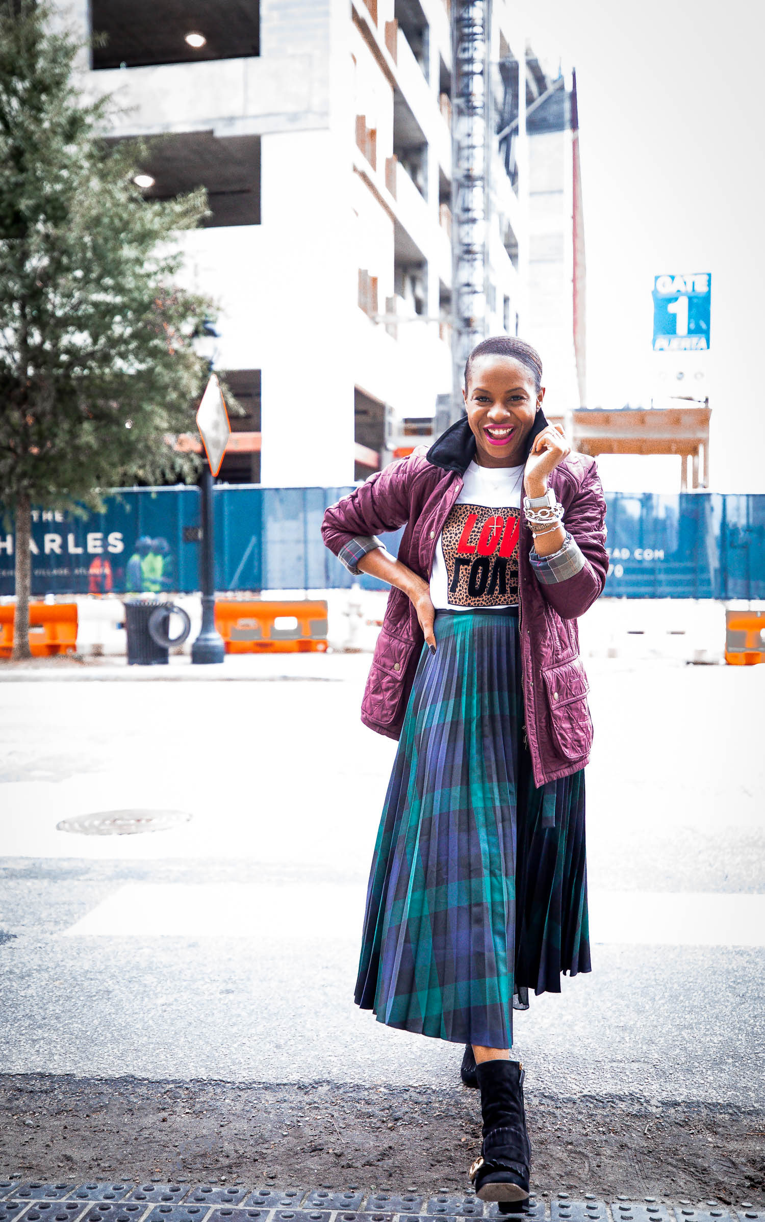 Atlanta fashion blogger shows you how to make a quilted coat stylish and on trend this fall/winter season. Barbour coat, sandro pleated midi skirt, love tee, gucci black suede booties