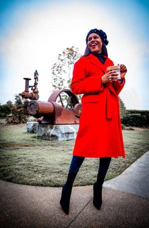Atlanta fashion blogger Monica Awe-Etuk in red Helmut Lang coat, black beret, black balenciaga sock boots selects the perfect holiday gifts for the favorite people in your life.