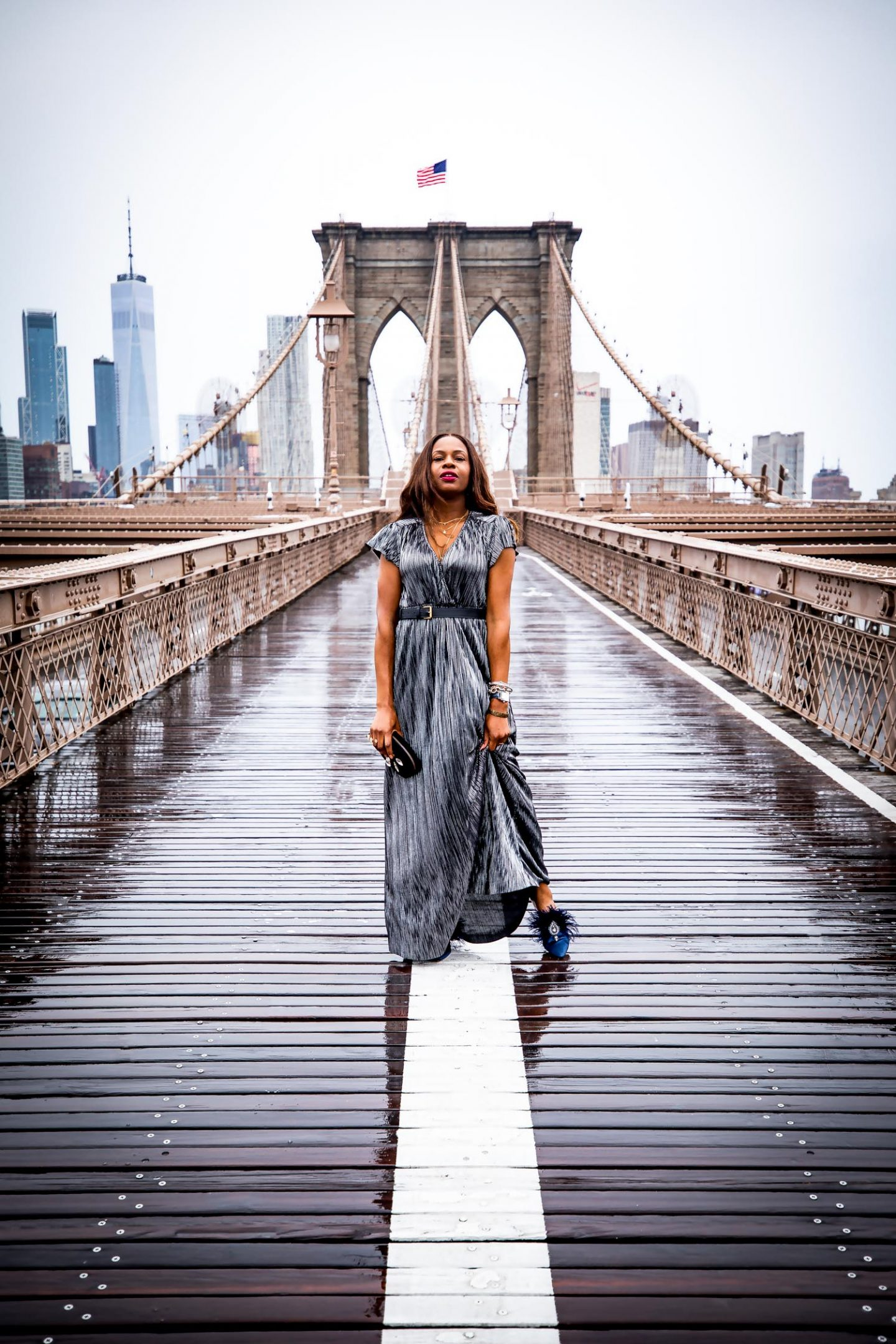 Atlanta blogger Monica Awe-Etuk explains what it takes to run a successful blog and 3 tips on how to be a successful blogger. One of Atlanta's most influential bloggers wearing metallic maxi dress by ladyee boutique, gucci belt bag, tory burch mules photographed on the Brooklyn bridge in New York city.