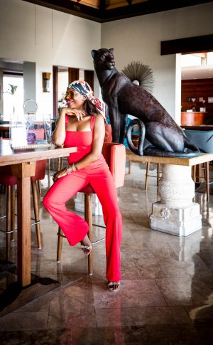 Atlanta lifestyle blogger Monica Awe-Etuk wearing a red jumpsuit from blackhalo, gucci oversized square sunglasses, givenchy silk scarf, Loeil clear tote, and alexandre Birman sandals-11