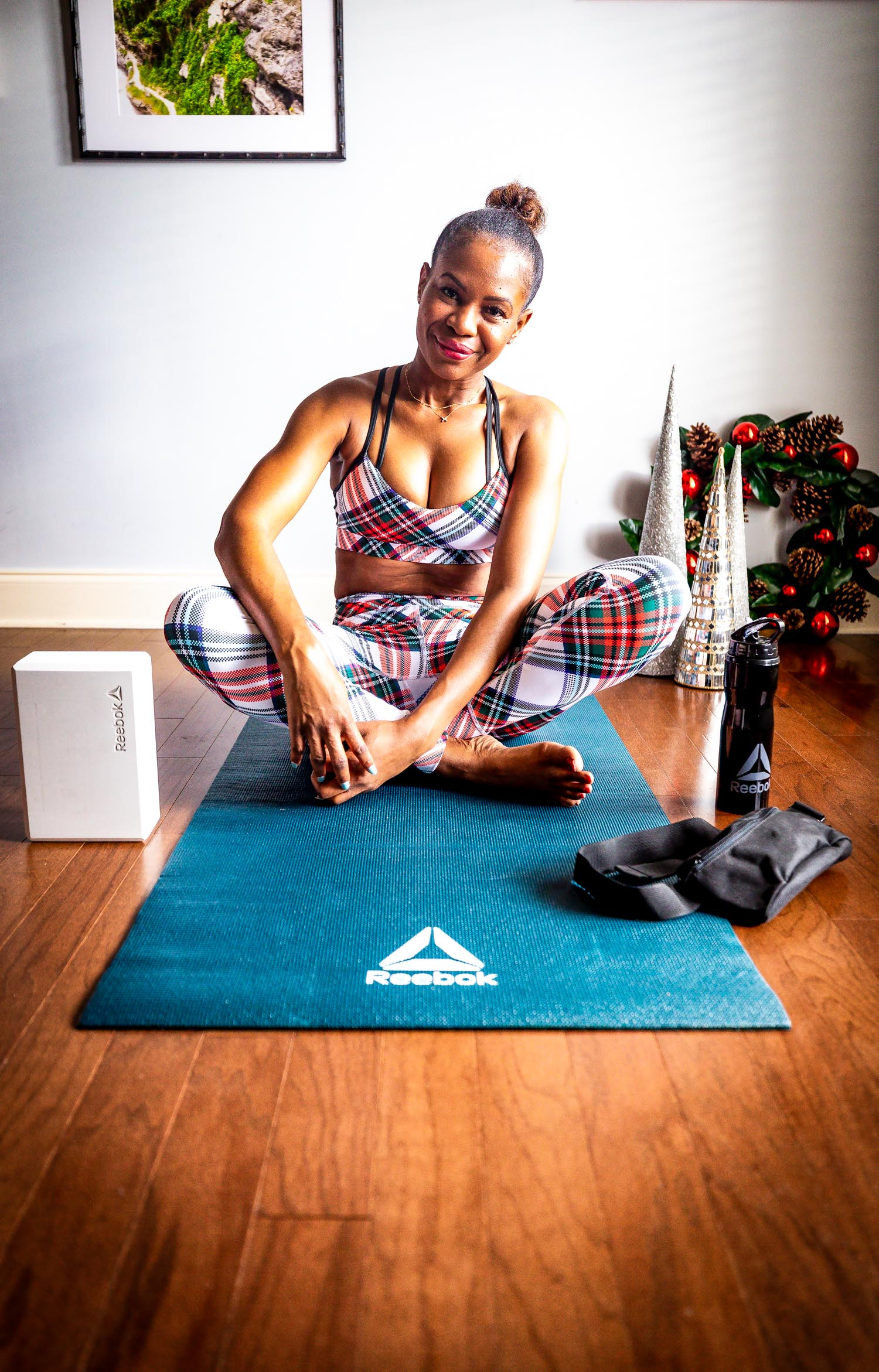Atlanta Lifestyle Blogger Monica Awe Etuk Wearing Reebok Plaid Leggings And Sports Bra Reebok Yoga Mat Yoga Block And Reebok Water Bottle For The Holiday 22 Awed By Monica