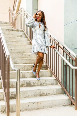 Atlanta lifestyle blogger Monica Awe-Etuk teams up with lemiga events to show you want to wear for holiday entertaining. holiday style tips. Wearing a sequins mini dress by keepsake the label from shopbop and blue sparkle mui miu shoes