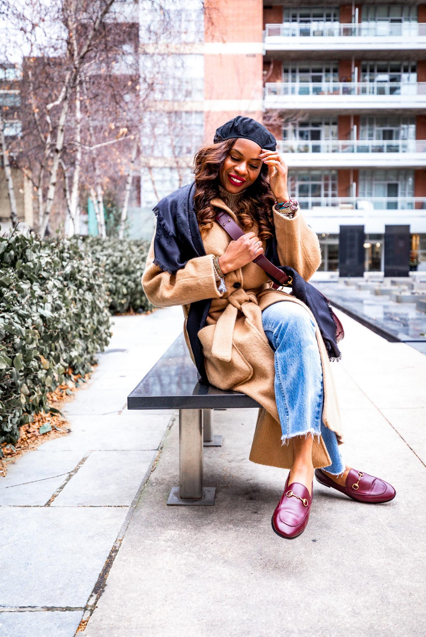 Atlanta blogger Monica Awe-Etuk wearing a Louis Vuitton scarf, camel coat, chloe tess medium bag, and gucci loafers