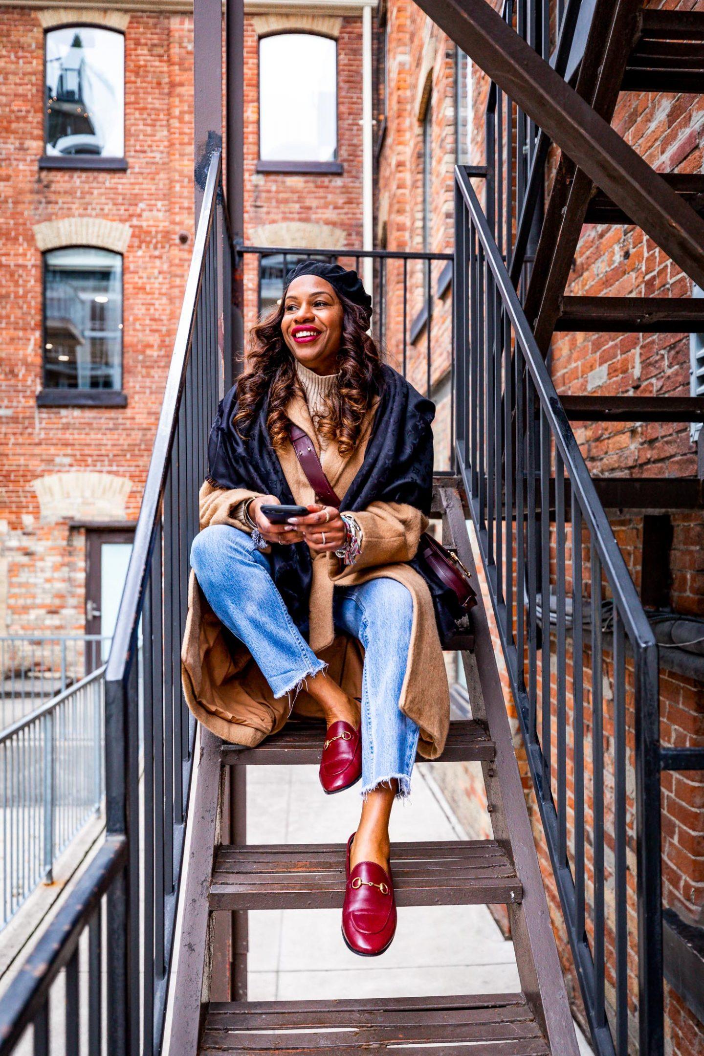 Atlanta blogger Monica Awe-Etuk wearing a Louis Vuitton scarf, camel coat, chloe tess medium bag, and gucci loafers