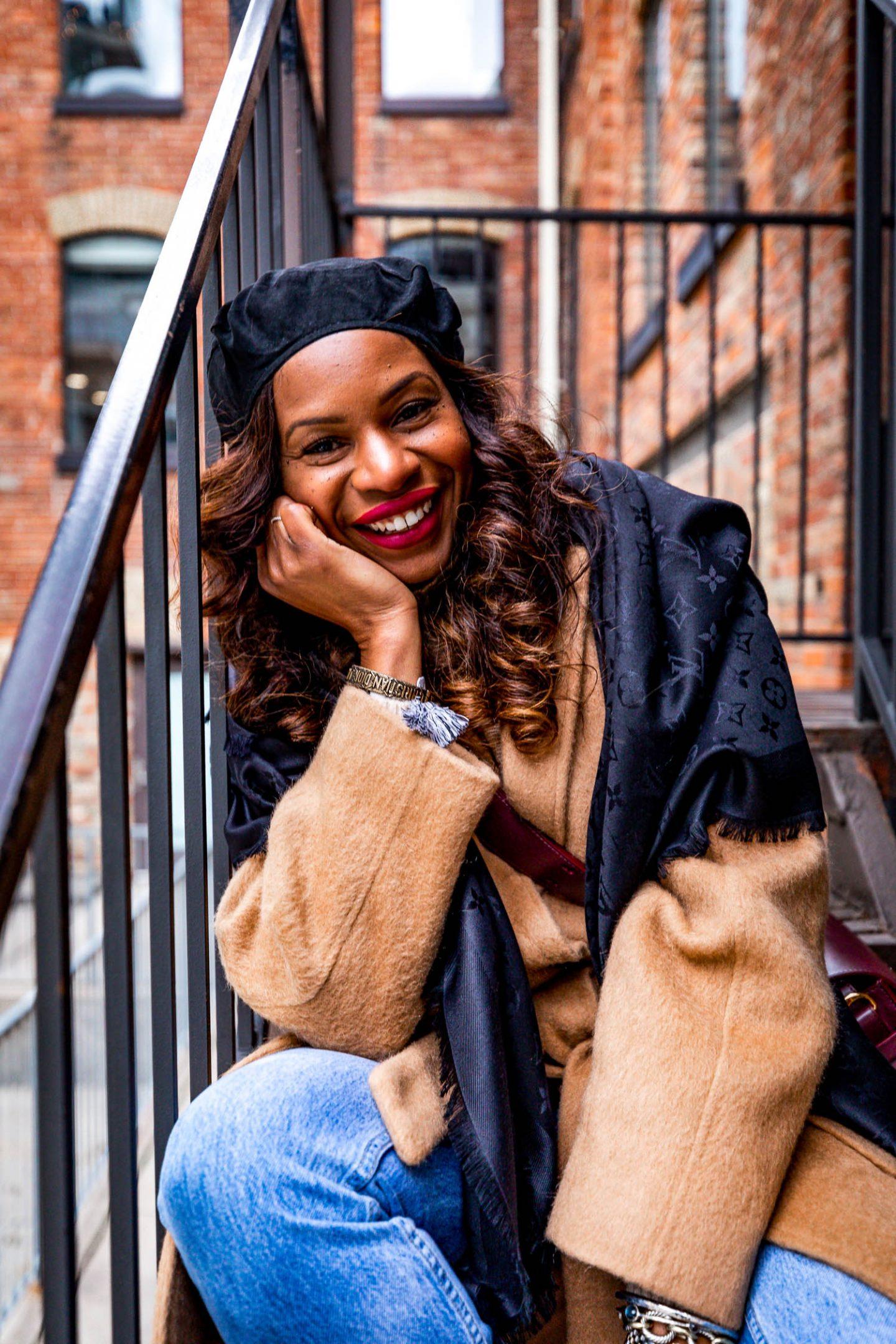 Atlanta blogger Monica Awe wearing a black louis vuitton scarf, camel coal, and black beret.