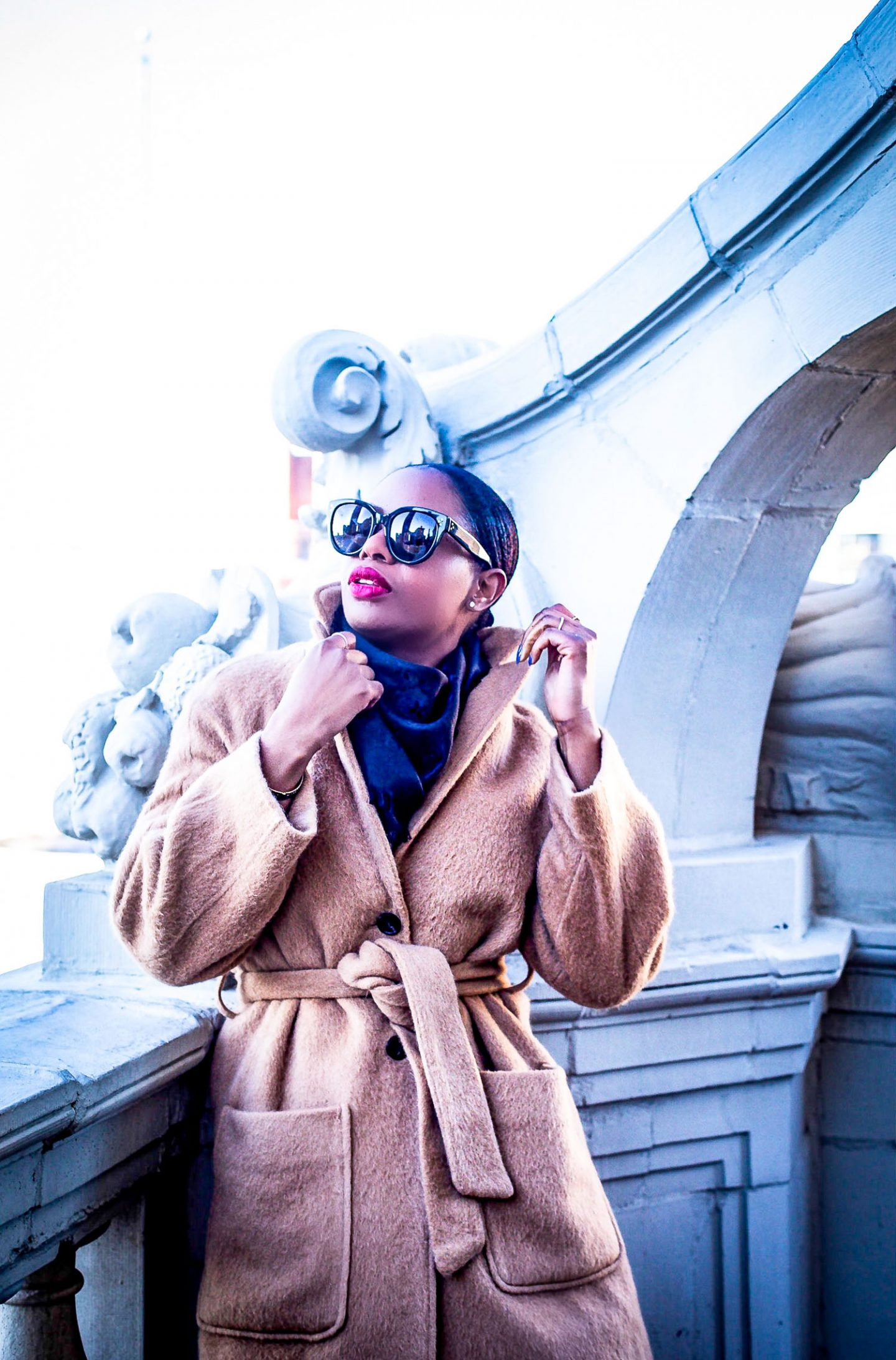 Atlanta fashion blogger Monica Awe-Etuk wearing an apiece apart camel mohair coat, celine cat-eye sunglasses, black louis vuitton scarf and balenciaga booties shows you why you should invest in a mohiar coat. Why these coats are worth every penny