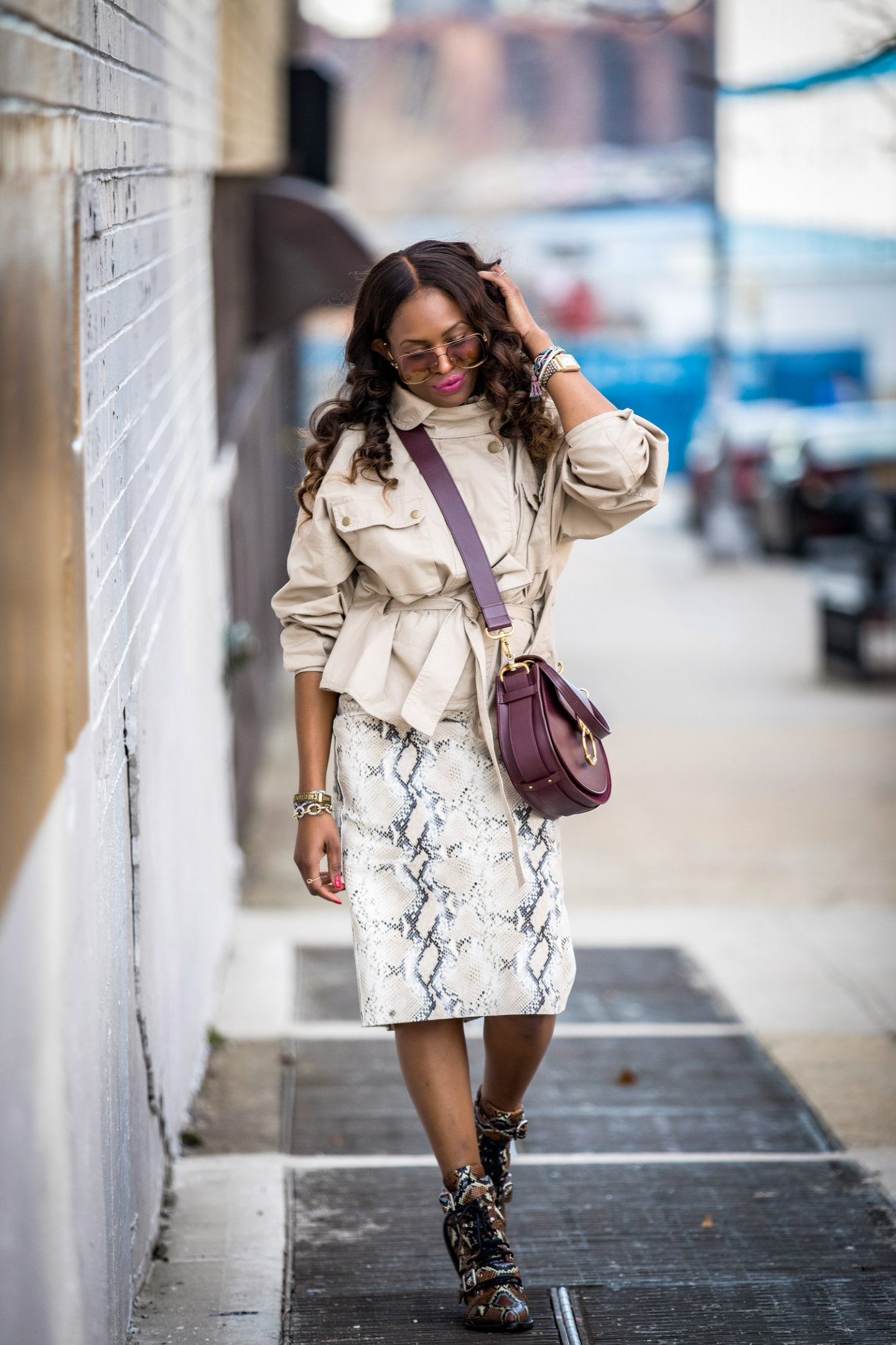 utility trend, utility chic, Atlanta lifestyle blogger Monica Awe-Etuk wearing a belted cargo jacket with a lafayette snakesin skirt and chloe snake boots. safari jacket belted jacket, Chloe tess bag, chloe bag, chloe sunglasses, chloe girl, utility jacket