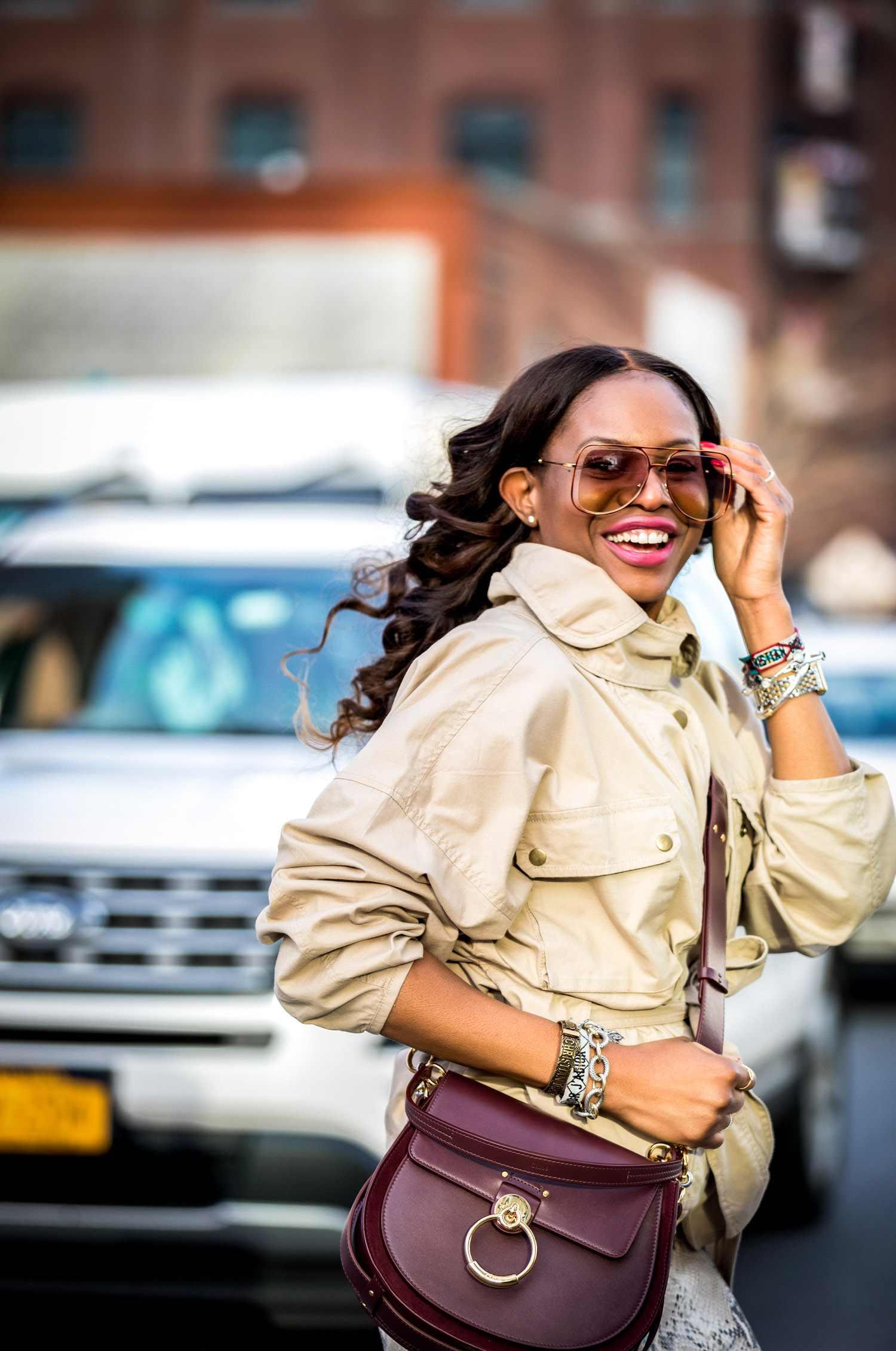 Atlanta lifestyle blogger Monica Awe-Etuk wearing a belted cargo jacket with a lafayette snakesin skirt and chloe snake boots. safari jacket belted jacket-3