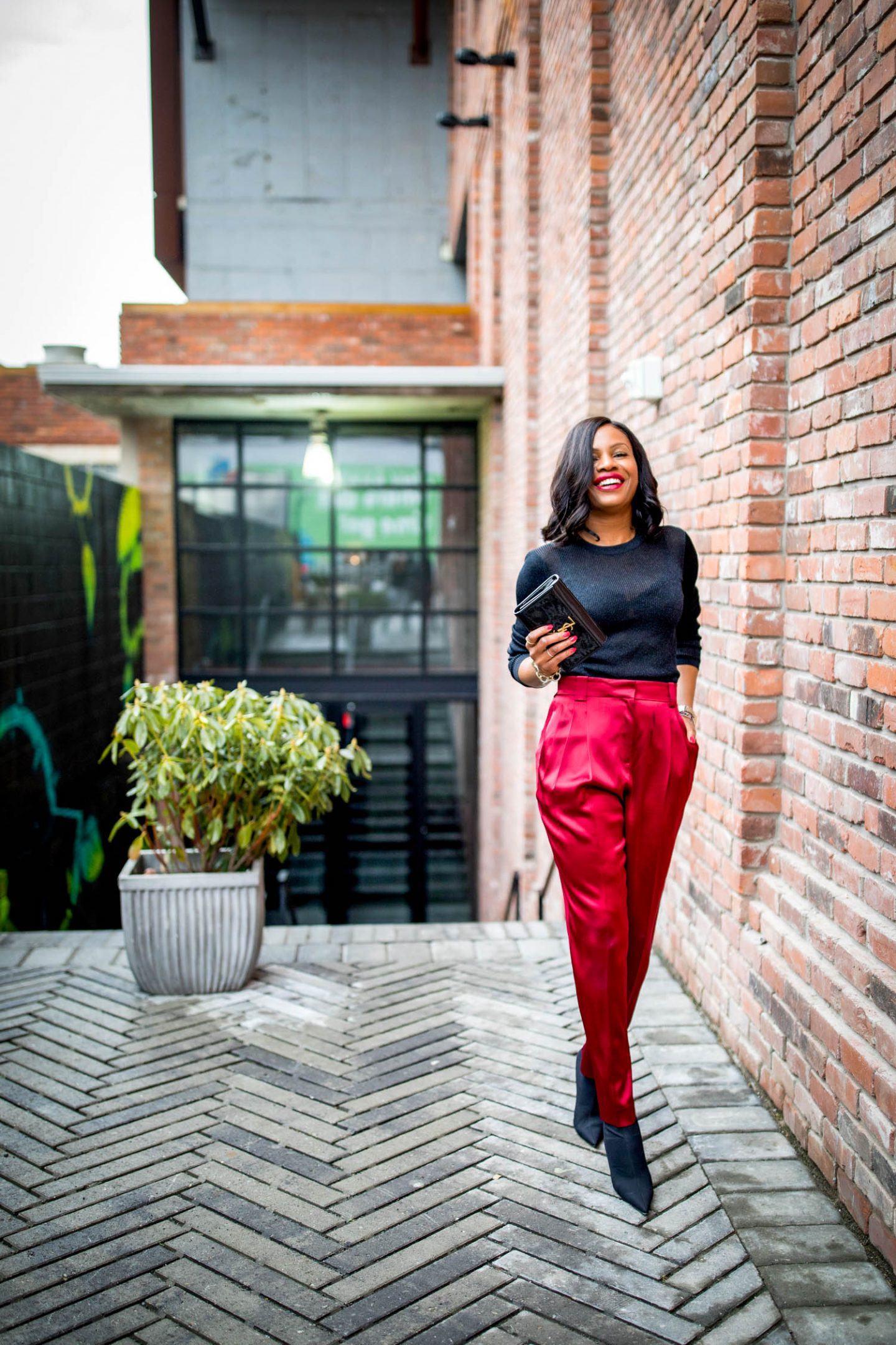 Atlanta blogger Monica Awe-Etuk wearing red silk pants from Lafayette143 ny, black balenciaga booties, ysl black patent leather clutch, and black vince top tells you everything you need to know about the suit trend and how to style suit separates