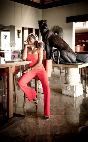 atlanta fashion blogger wearing a black halo coral jumpsuit, givenchy silk scarf, gucci sunglasses and clear bag in mexico