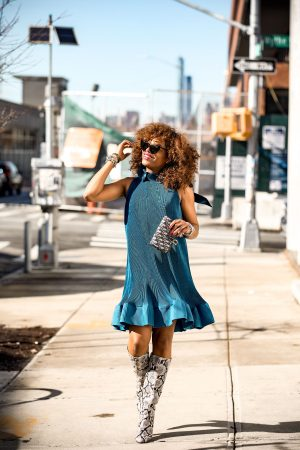 Atlanta Fashion blogger Monica Awe-Etuk wearing a blue tibi pleated dress, jcrew snake boots, ysl heart sunglasses, dior oblique belt bag worn as a clutch-10
