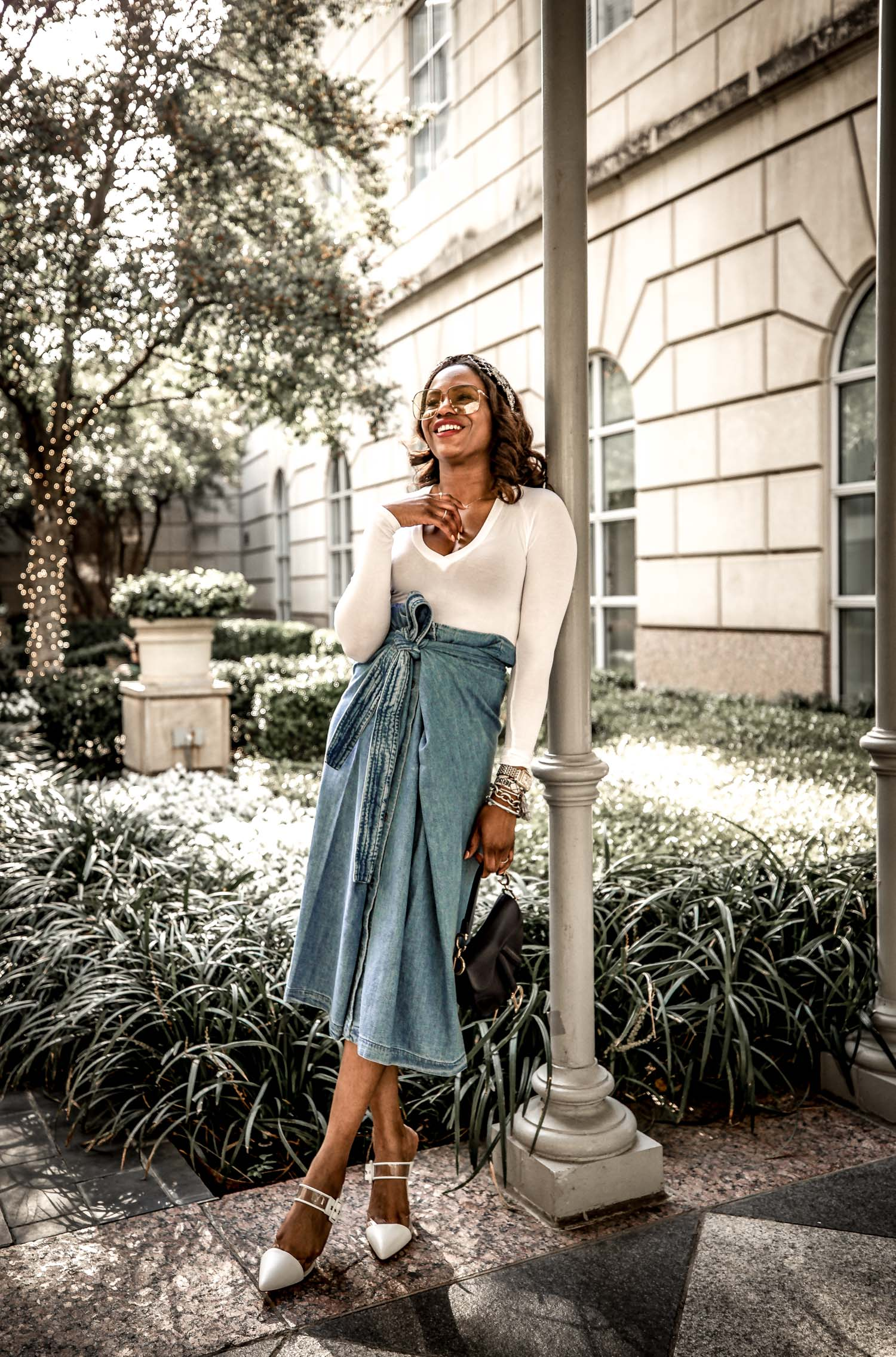 Atlanta fashion blogger Monica Awe-Etuk wearing levis midi skirt with white long sleeve v-neck top, embelished head band, gucci square sunglasses, dior saddle bag and white clear mules-8