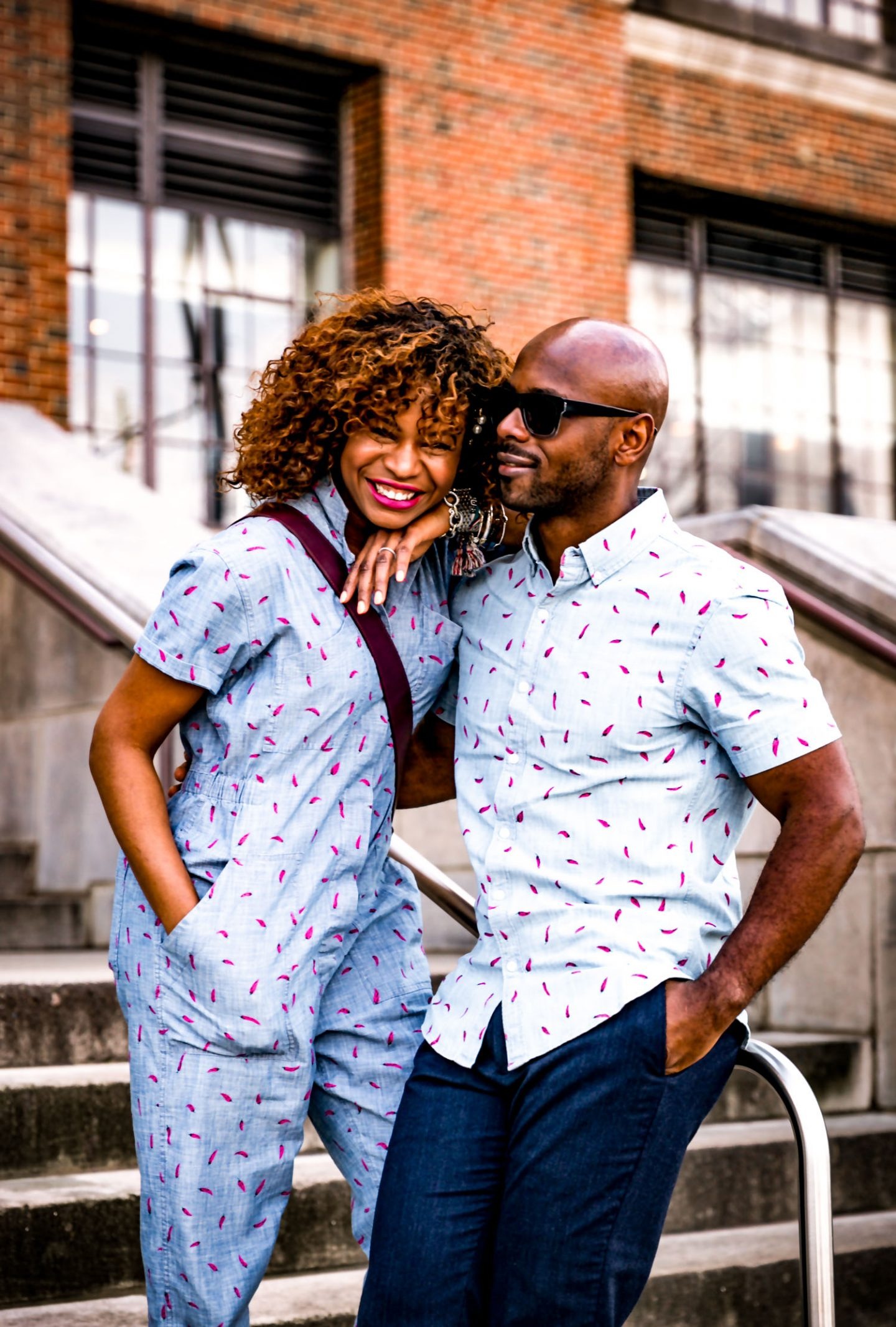 Atlanta lifestyle blogger Monica Awe-Etuk and her husband wearing bonobos spring collection for women's month. blue and red jumpsuit, chloe bag and bonobos pants