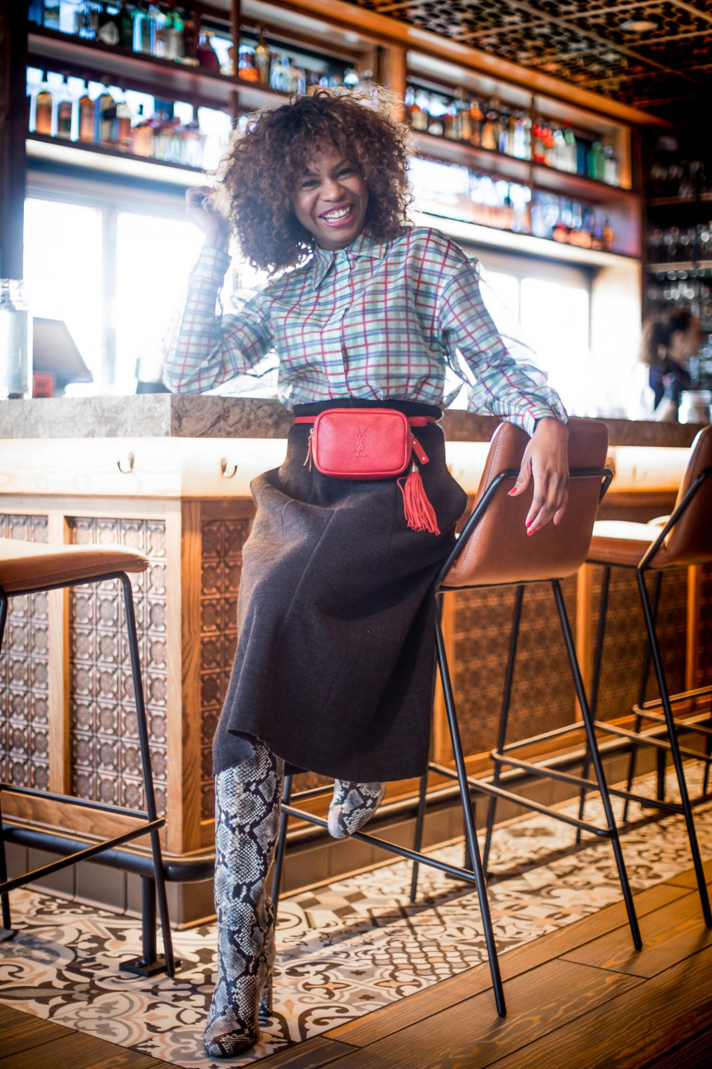 Atlanta lifestyle blogger Monica Awe-Etuk wearing a red ysl belt bag, j.crew knee-high boots, & other stories plaid shirt at atlanta resturants
