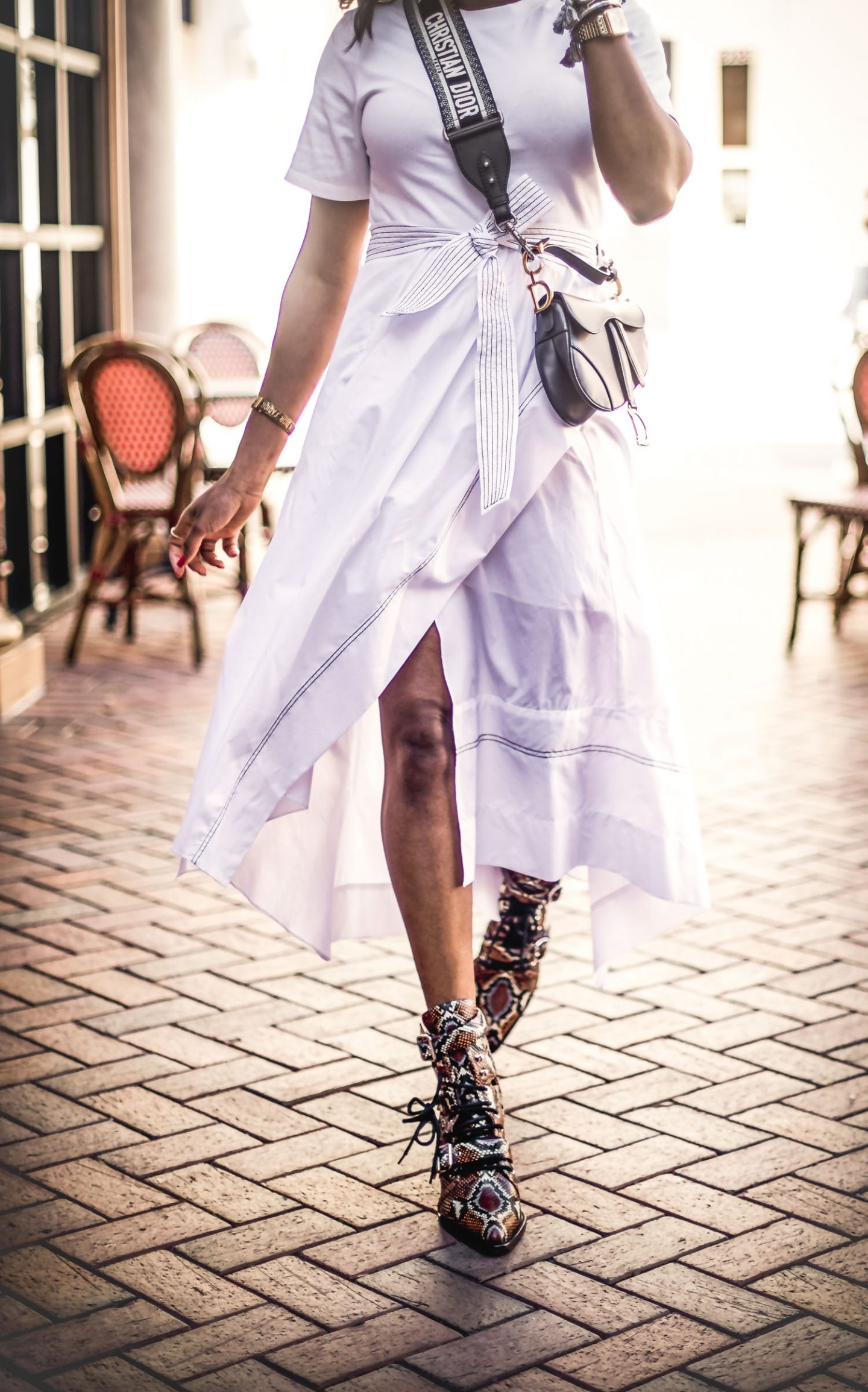 Atlanta lifestyle blogger Monica Awe-Etuk wearing a white 3.1 philip lim midi dress, chloe sunglasses, chloe snakeskin boots, dior saddle bag. How to style snakeskin boots for spring