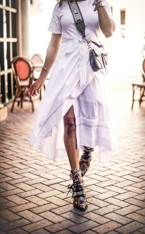 Atlanta lifestyle blogger Monica Awe-Etuk wearing a white 3.1 philip lim midi dress, chloe sunglasses, chloe snakeskin boots, dior saddle bag