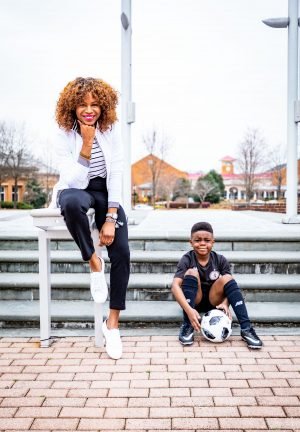 Atlanta lifestyle blogger Monica Awe-Etuk creates 2 stylish mom outfits for soccer moms on the go. Wearing talbots X Oprah collection to drop off her kids for soccer and gymnastics. white and black sports jacket, black crop pants with stripe detail, black and white stripe tee, white superga sneakers,