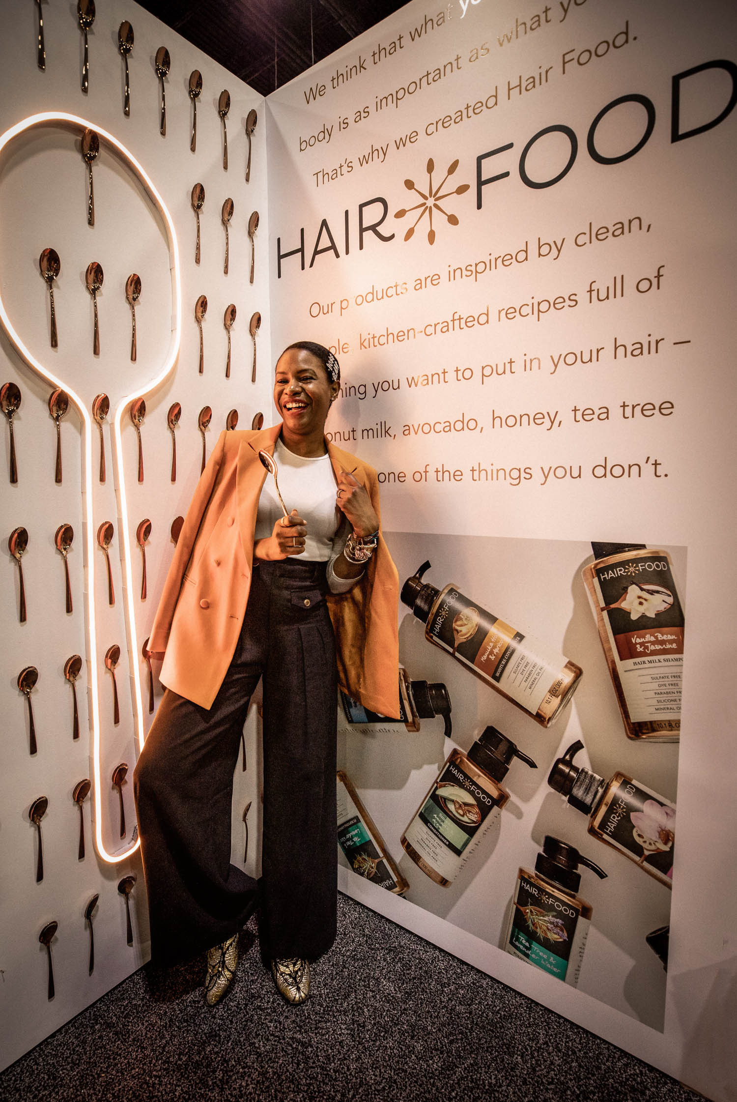 Atlanta fashion blogger Monica Awe-Etuk uses hair food products inspired by super foods like coconut, at the ulta gm conference in atlanta