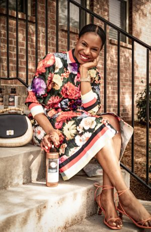 Atlanta fashion blogger Monica Awe-Etuk uses hair food products. wearing an alice and olivia floral dress, rejina pyo sandals, and spring bag.