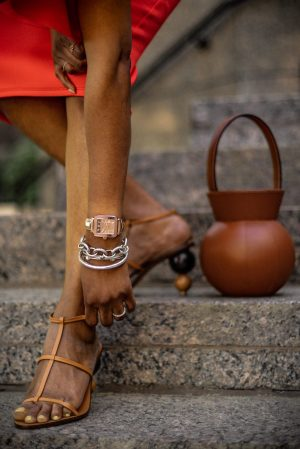 Atlanta fashion blogger Monica Awe-Etuk wearing orange dress for mother's Day. What to wear for Mother's Day. michele shine watch. The perfect mothers day outfit featuring a orange scuba midi dress, staud brown round bag, cult gaia brown sandals