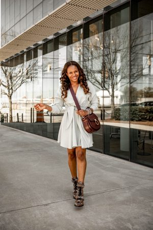 Atlanta fashion blogger Monica Awe-Etuk wearing tibi wrap dress, chloe snake boots, Chloé - Medium Tess Leather Saddle Bag for spring. The best spring dresses