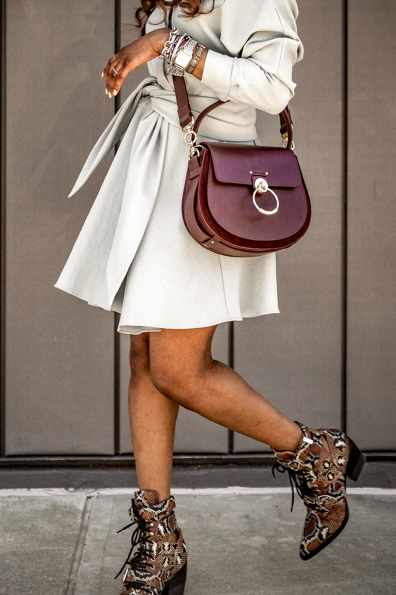 Atlanta fashion blogger Monica Awe-Etuk wearing tibi wrap dress, chloe snake boots, Chloé - Medium Tess Leather Saddle Bag for spring. The best spring dresses