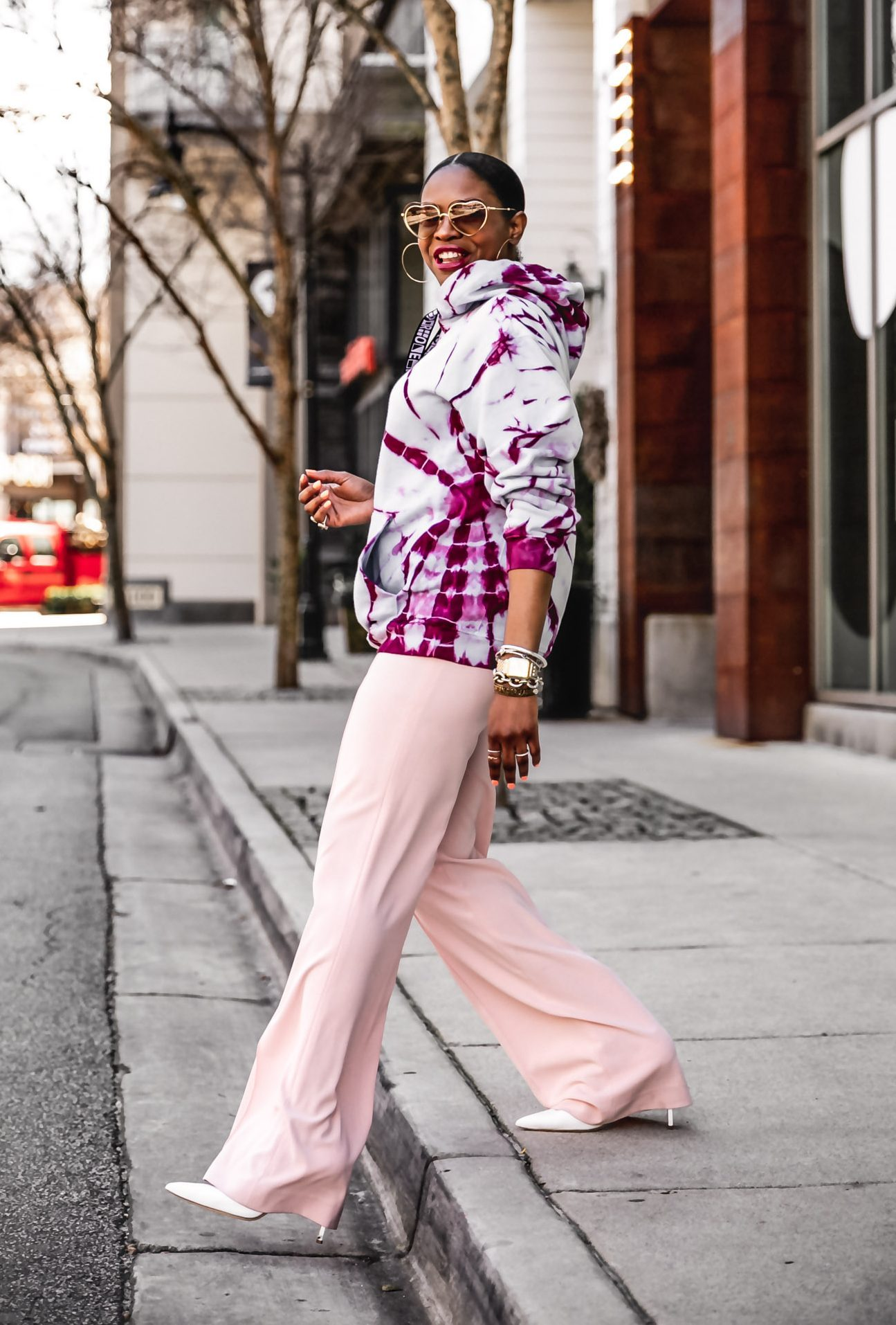 Atlanta fashion bloggers Monica Awe-Etuk wearing a proenza schouler alice and olivia high waist pink pants, chloe heart sunglasses, dior friendship bracelets, shows you how to wear the tie-dye trend