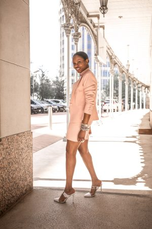 Atlanta fashion bloggers Monica Awe-Etuk wearing pink short suit for spring, white t-shirt and white clear mules - spring suit for work