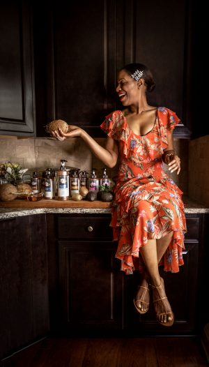 blogger Monica Awe-Etuk tries hair food wearing a red floral maxi dress, glam and boss hair pins, and cult gaia sandals