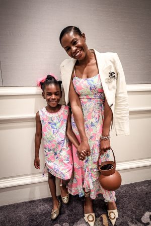 atlanta fashion and lifestyle blogger and daughter wearing lilly pulitzer matching dresses, staud bucket bag, glam hair pin, white linen blazer, chanel pins and cult gaia shoes