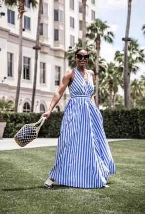 Atlanta blogger Monica Awe-Etuk wearing jcrew wide leg halter jumpsuit, white sandals, d&g black cat eye sunglasses and staud bag-2