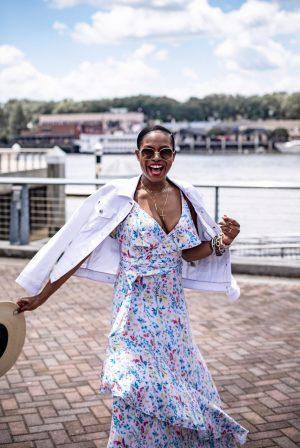 Atlanta blogger Monica Awe-Etuk wearing white denim jacket and maxi floral dress from walmart and chanel sunglasses