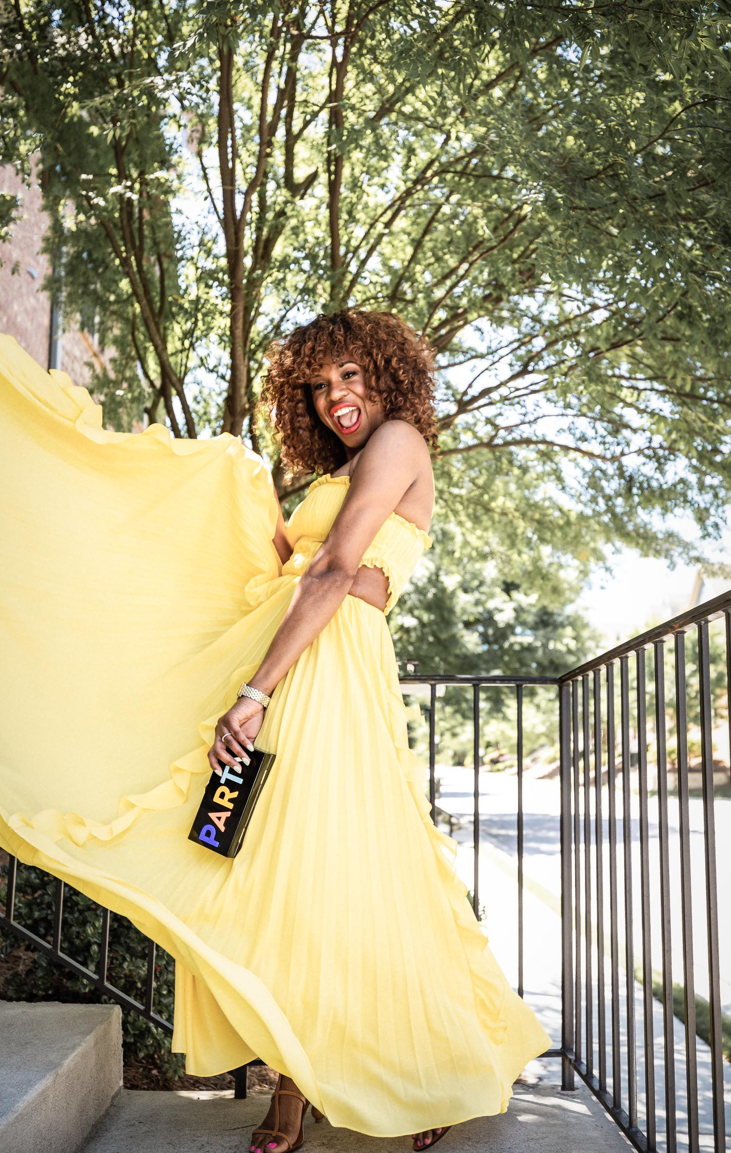 Atlanta blogger Monica Awe-Etuk wearing yellow maxi dress, cult gaia sandals and milly clutch. How to achieve the perfect wedding guest look with 3 summer wedding makeup tips for an industry expert.