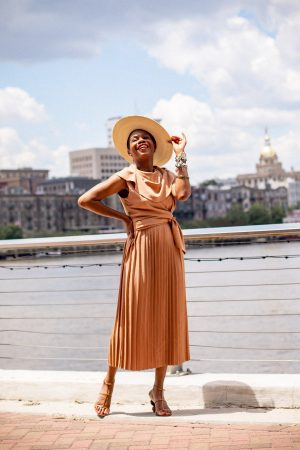 Atlanta blogger Monica Awe-Etuk wearing brown pleated midi dress from asos and cult gaia shoes. How to wear brown in the summer