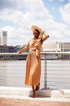 Atlanta blogger Monica Awe-Etuk wearing brown pleated midi dress from asos and cult gaia shoes-4