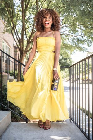 Atlanta blogger Monica Awe-Etuk wearing yellow maxi dress, cult gaia sandals and milly clutch-3