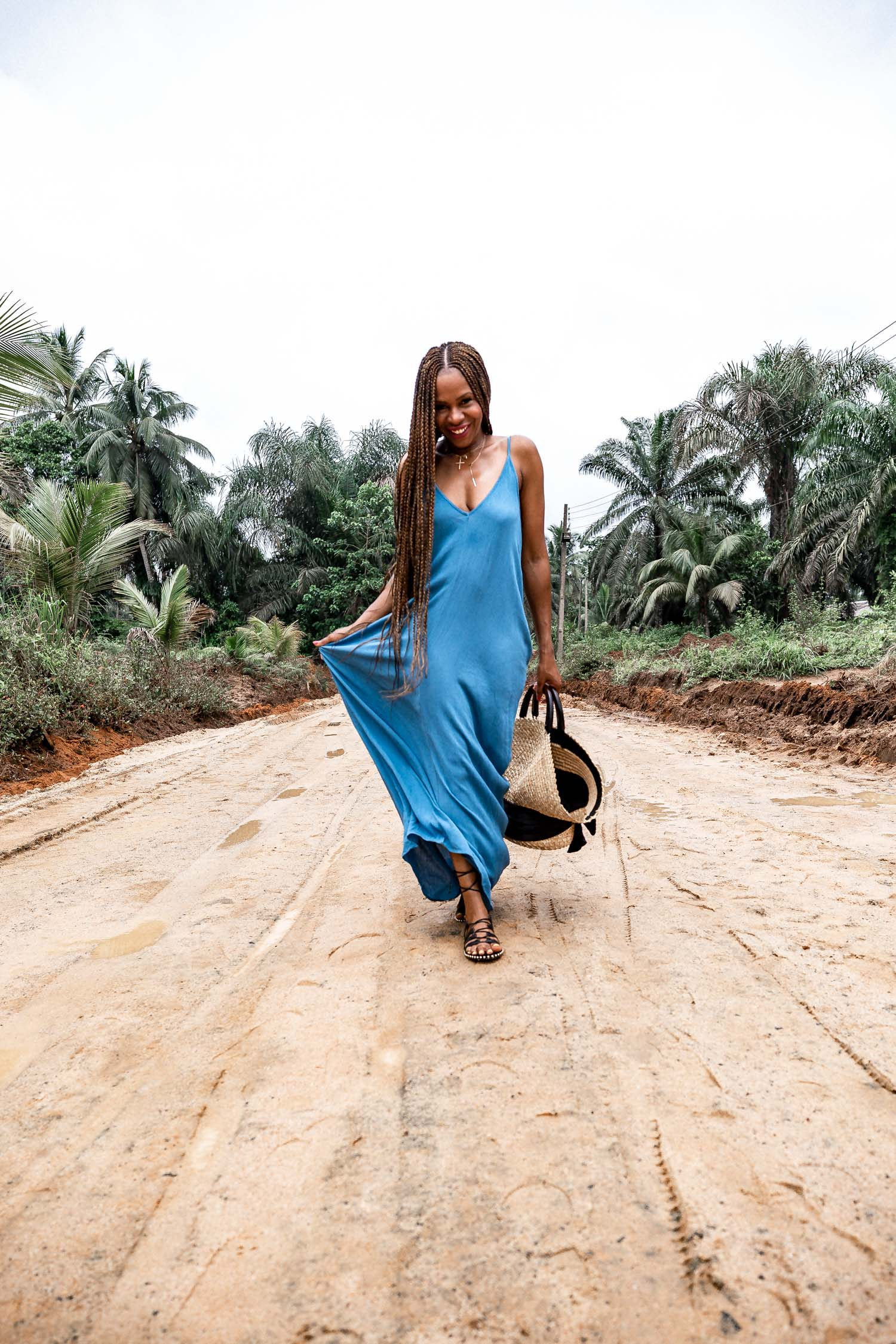 Atlanta fashion and lifestyle blogger Monica awe-etuk wearing a blue maxi dress in nigeria, nordstrom rack dresses, black sandals, straw bag-3
